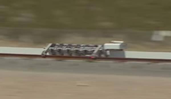 Hyperloop One Pod open-air test model speeding through the desert